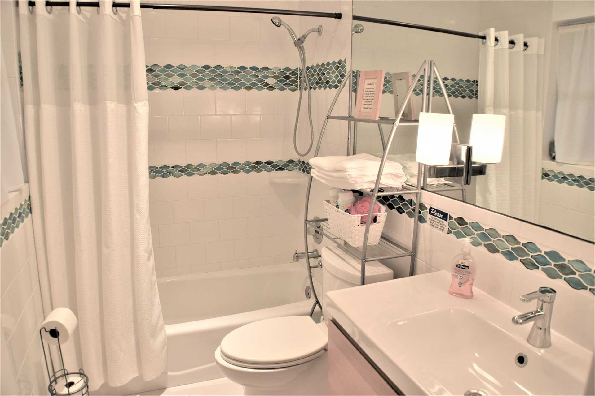 Third bedroom has ensuite bathroom with combo tub and shower