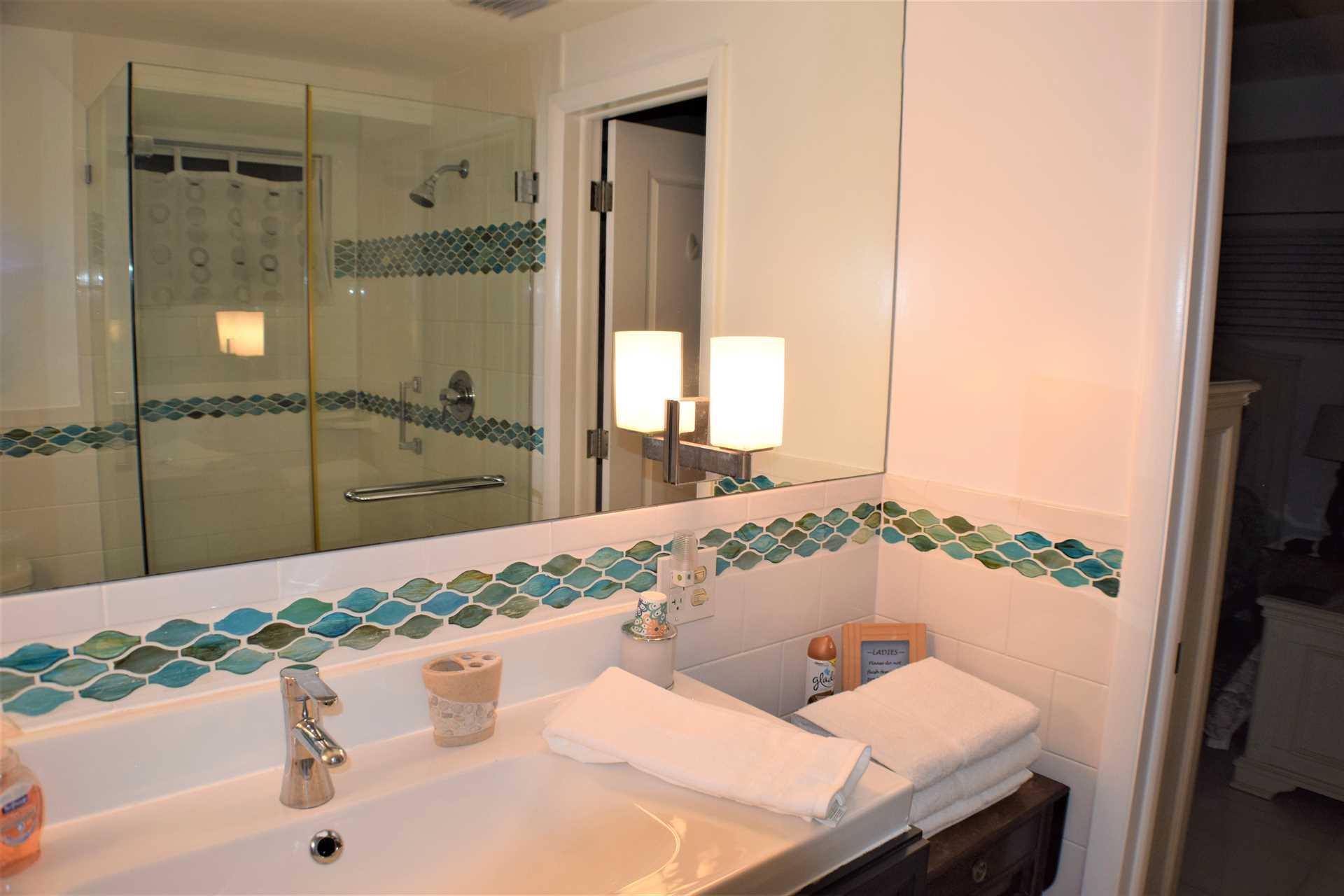 First floor bath has huge walk in shower.