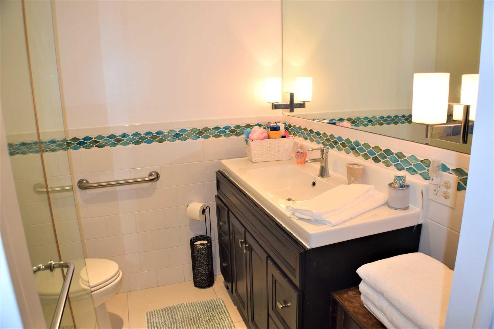 First floor bath is just off the bedroom.