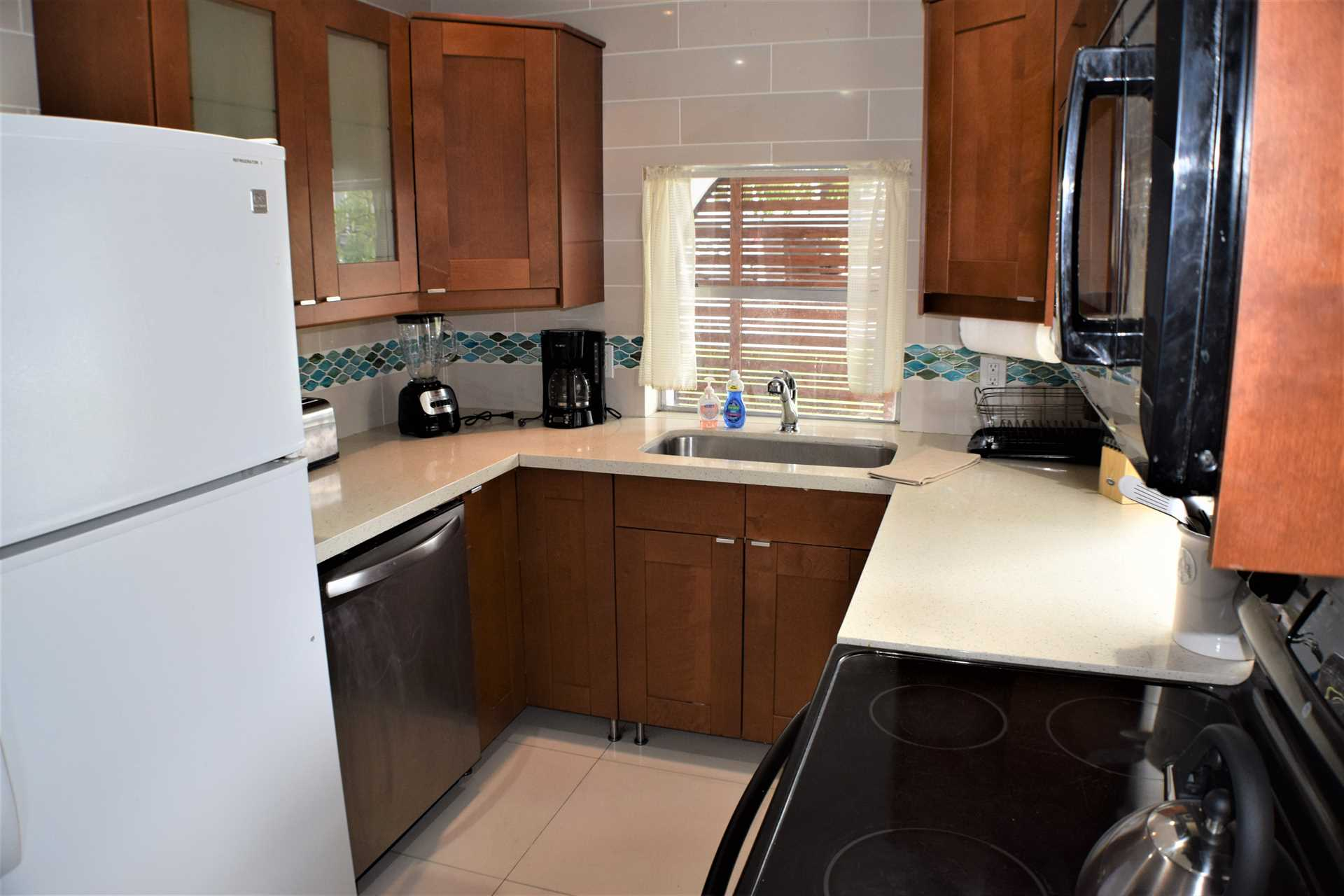 Galley kitchen features include all small appliances and a w