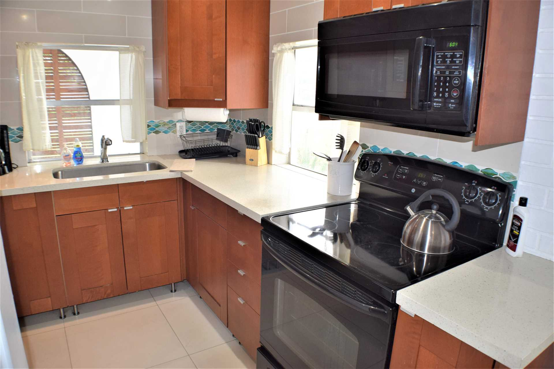Kitchen has cooktop range and oven plus microwave.