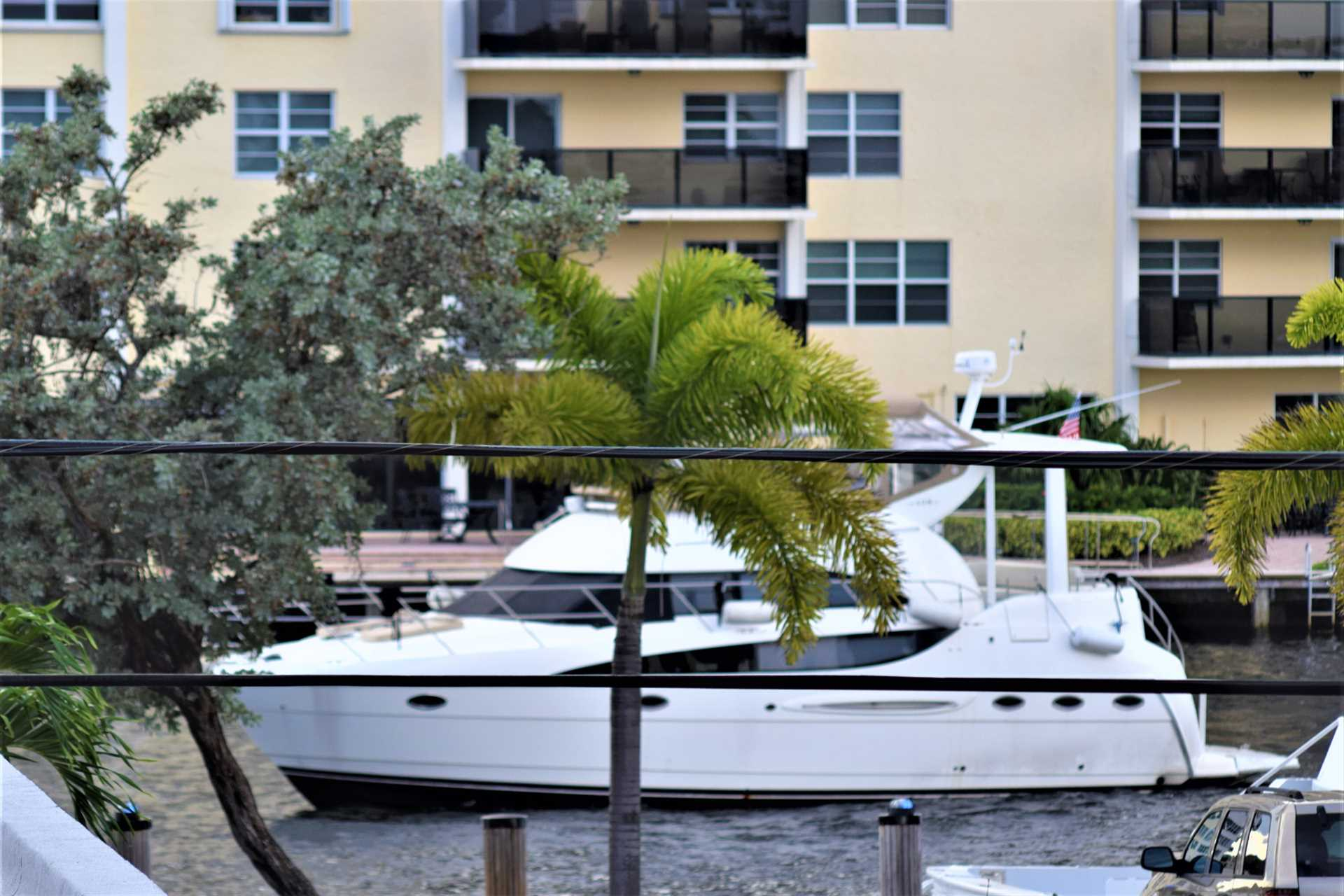 Watch yachts cruise the intracoastal waterway from your sun