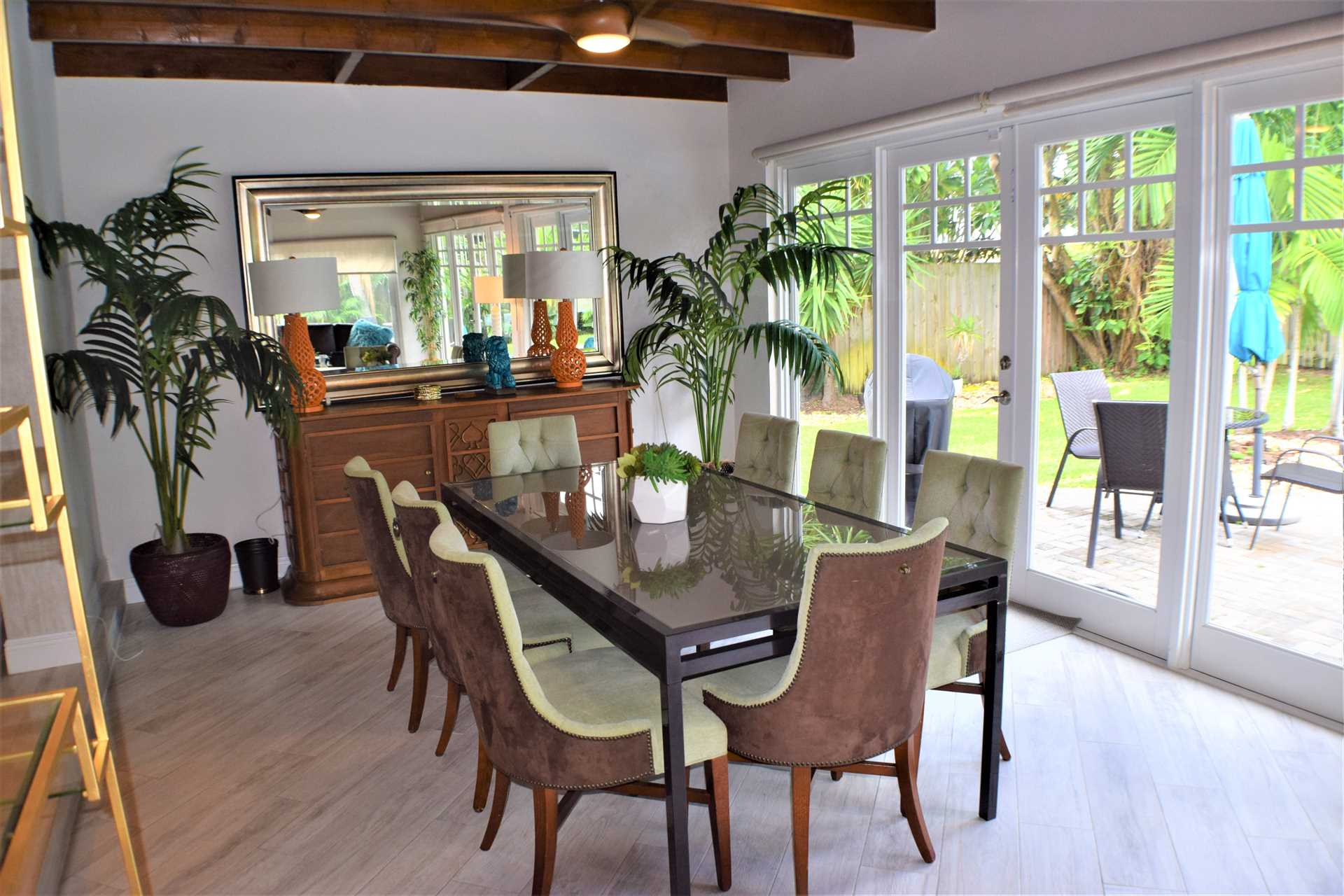 Dining area overlooks and opens to the pool deck.