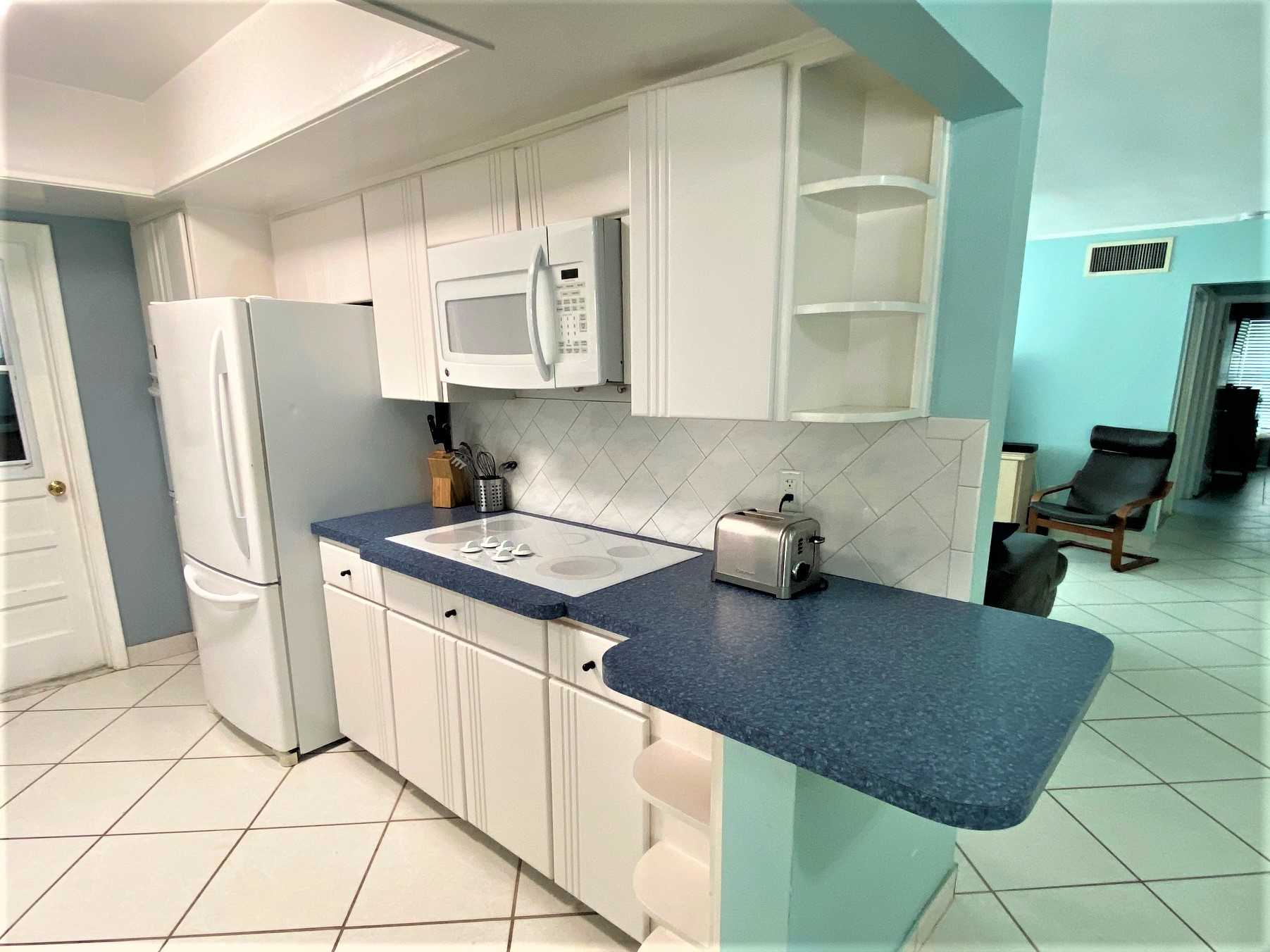 Kitchen has cooktop, microwave and conventional oven.