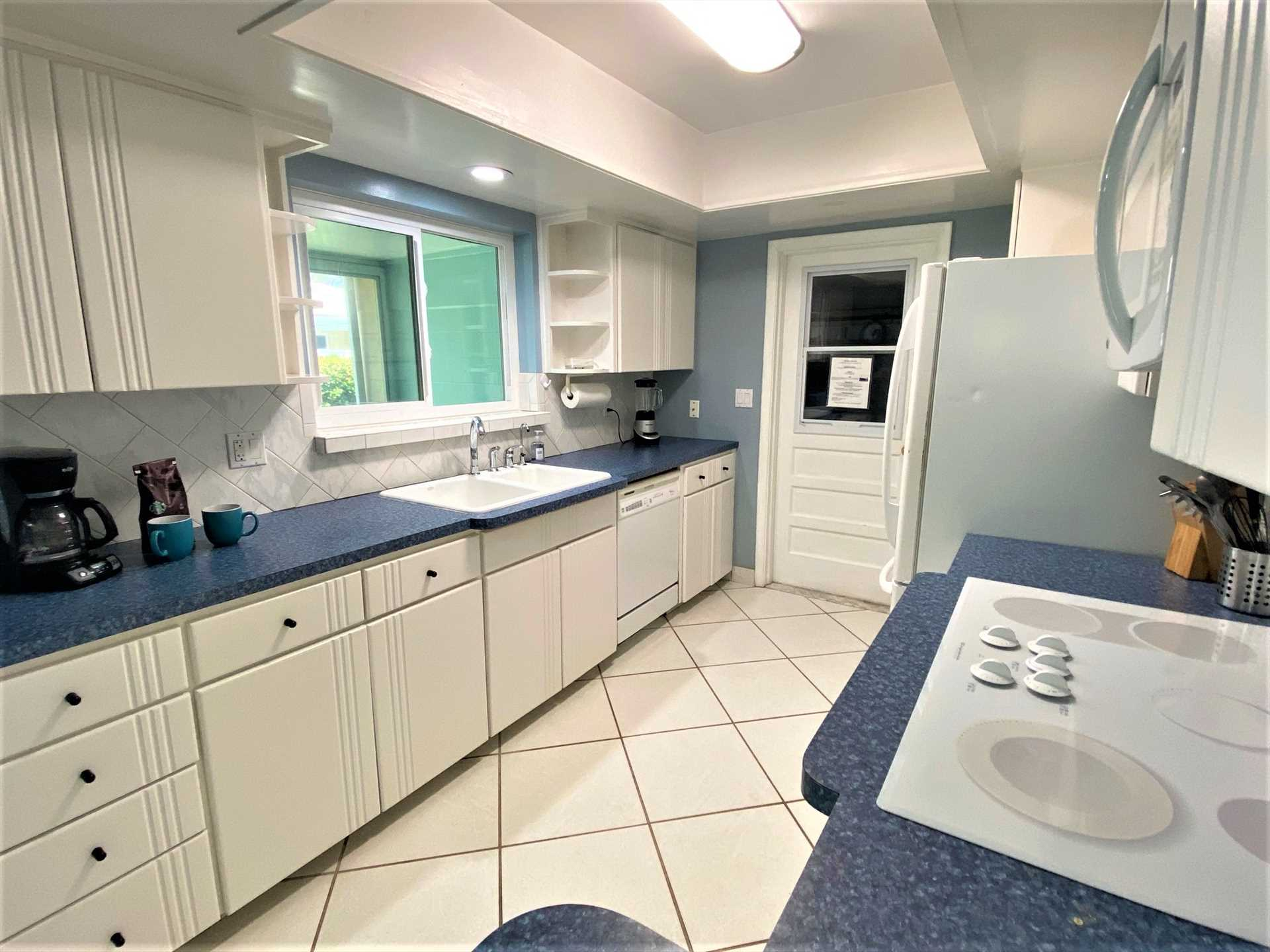 Fully equipped kitchen has all appliances, dishes, cookware
