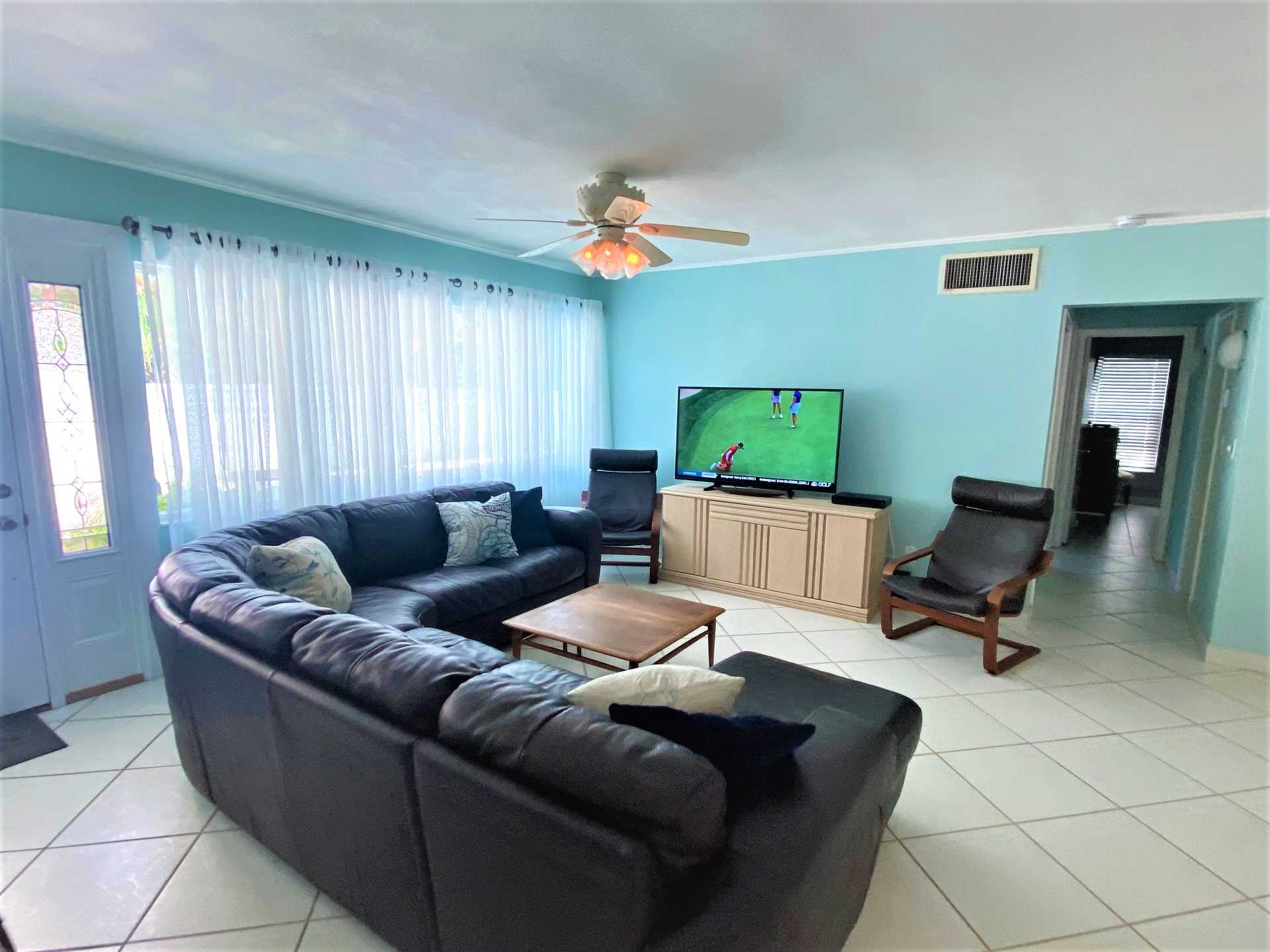 The living area features a big screen HDTV with Xfinity Comc