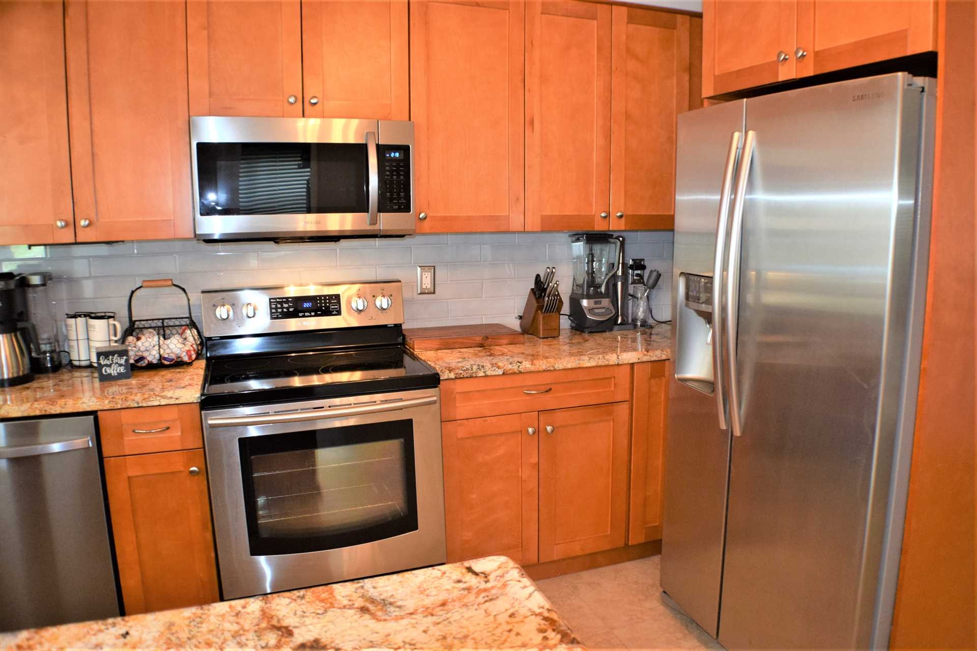 The kitchen features all stainless appliances