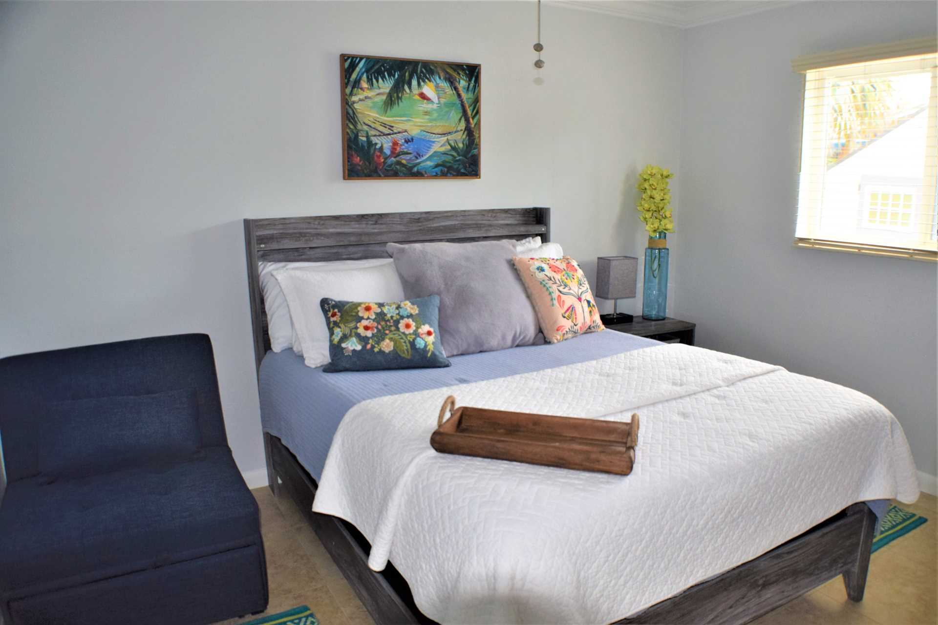Third bedroom has queen bed and convenient chair which conve