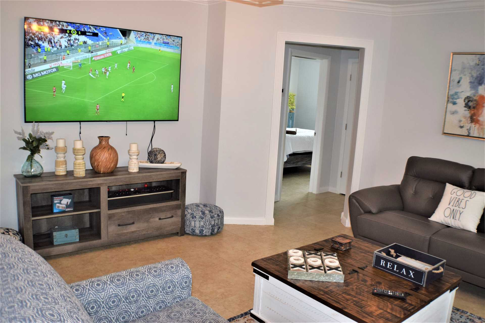 Living room features large flat screen HDTV